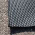 Hammered rubber mat for cattle chute